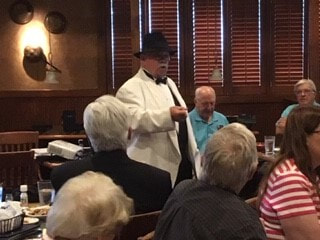 "Don Moon Story Teller, in character of Bootlegger ""Fast Eddy"" & his historical picture of Prohibition in the USA."